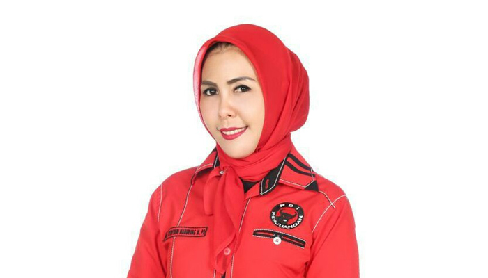 Hj. Fitriani Manurung